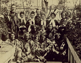 Southern Plains Delegation at White House Conservatory (Back Row, L-R): Interpreter W. N. Simpson Smith; Agent Samuel G. Colley; unidentified man and four women; and, (Far Right): Possibly Mary Todd Lincoln; (Front Row, L-R): War Bonnet; Standing In The Water; Lean Bear, 27 March 1863, Smithsonian