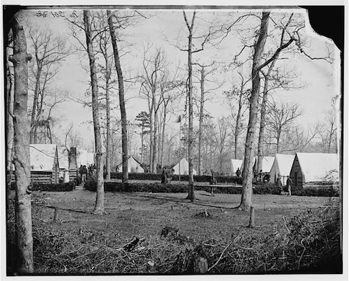 Cornelia Hancock in hoop skirt at far right at Brandy Station, Virginia. Field hospital of the 3rd Division, 2d Corps, courtesy Library of Congress.